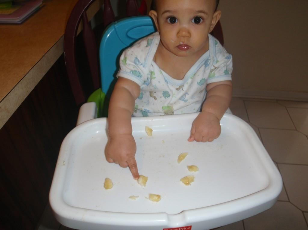 baby eating bananas