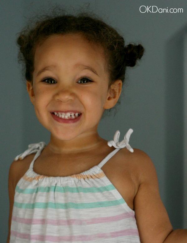 cute biracial baby smiling